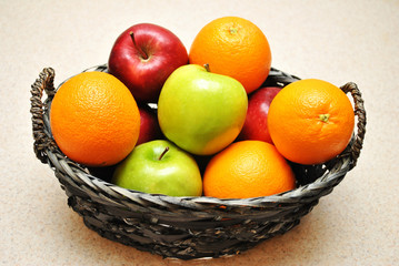 A Old Basket Filled with Apples and Oranges