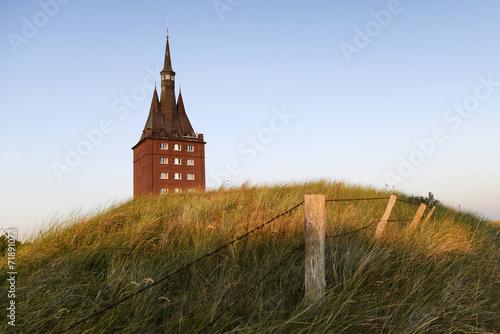 Leinwanddruck Bild The west tower of the island of Wangerooge