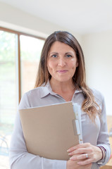 Business woman holding documents