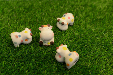 Cow doll on the grass.