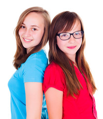 Two teen girls standing back-to-back