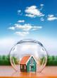 Insured house under glass sphere