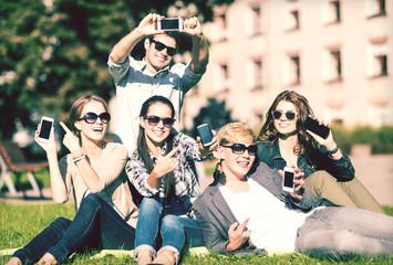students showing smartphones