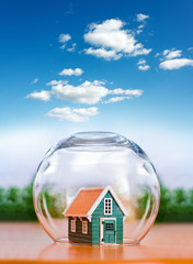 Insured house under glass sphere