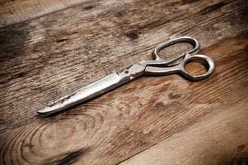 old scissors on the wooden table