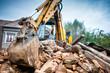 Leinwandbild Motiv Hydraulic crusher excavator backoe machinery working on site