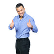 Happy business man with thumbs up gesture, isolated over white b