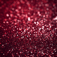 Abstract red christmas defocused glitter background