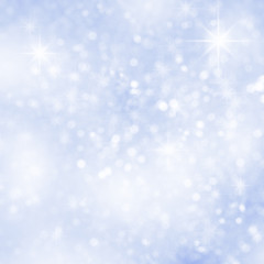 Abstract blue christmas snow background with defocused sparkles.