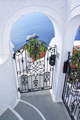 Gate and panorama from Santorini island - Greece