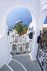 Gate and panorama from Santorini island - Greece