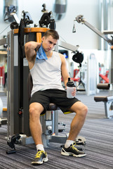 man exercising on gym machine