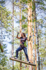 adventure park , brave woman on a rope