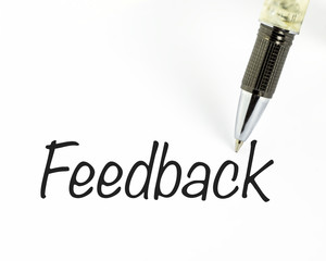 Pen writes feedback word on paper