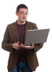 man with laptop smirking