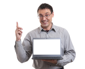 portrait of confident young man advertising laptop