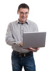 Happy man holding laptop