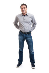 Happy smiling young man standing full length