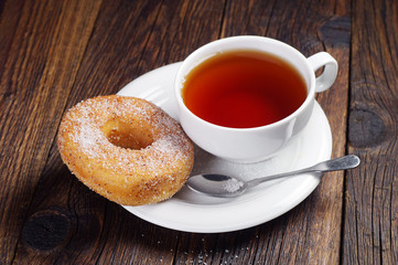 Sweet donut and tea cup