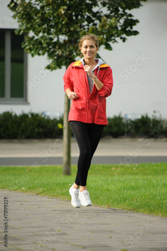 canvas print picture Junge Frau joggt Outdoor