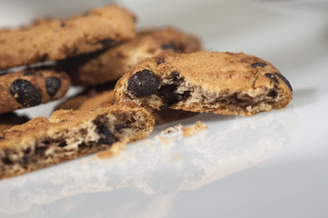 chocolate cookies with sugar, coffee and cup background