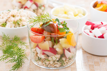 salad with fresh vegetables and cottage cheese in a glass