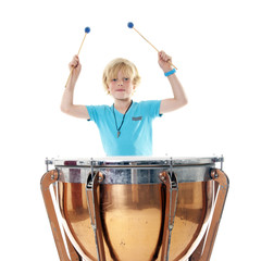 young blond boy playing kettle drum