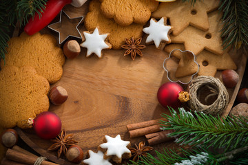 wooden background with Christmas cookies and ingredients
