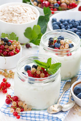 yogurt with berries and products for healthy breakfast, top view