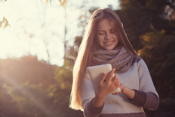 Smiling teen girl posing with tablet