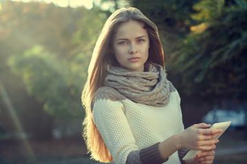 Beautiful teen girl posing with tablet