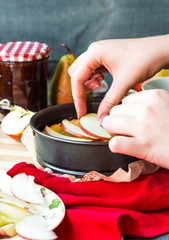 the process of making apple tart, hands