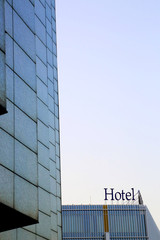 Hotel sign on the top of modern building