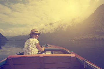 Vintage photo of woman boating