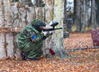 Young paintball player shooting
