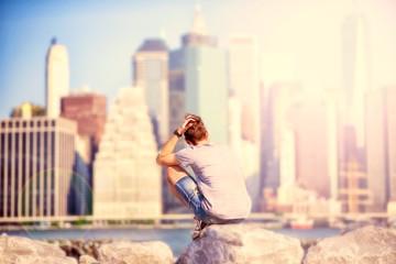 Youn adult is enjoying Manhattan view