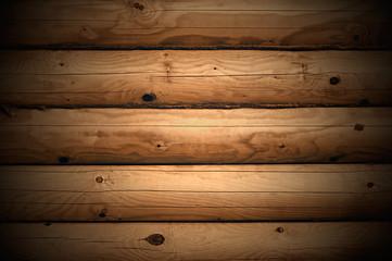 Wall made of wooden logs closeup.