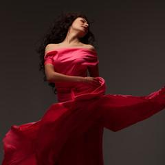 beautiful girl in a long pink dress