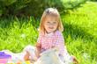 Happy little girl in the Sunny meadow