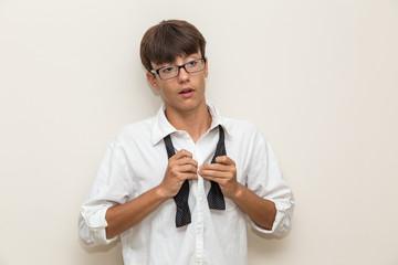 Boy with undone bow tie