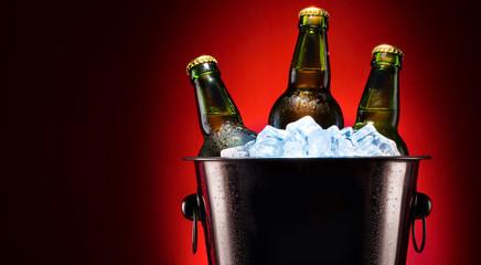 Beer bottles in ice bucket