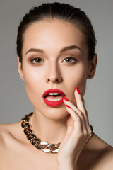 Beauty portrait of surprised young brunette woman