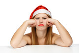 Young woman in santa hat with scowl look poster