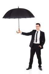 Insurance agent holding an open umbrella