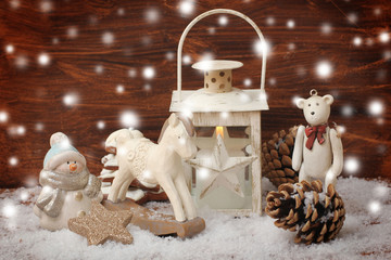 rocking horse,teddy bear and lantern on christmas background