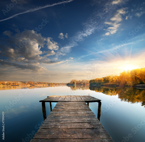 Foto op Aluminium Rivier Pier on a calm river