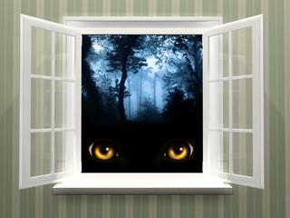 Eyes of monster  in open window
