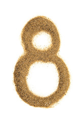 Number 8 made of sand isolated on white