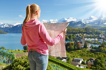Girl looking to the map. Switzerland