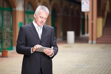 adult businessman with digital tablet